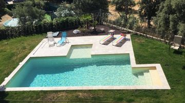 Lijar y pintar piscina